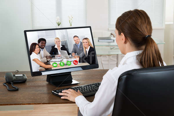 Businesswoman Videochatting With Colleagues On Computer Stock photo © AndreyPopov