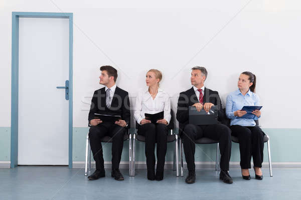 Businesspeople Sitting On Chair For Giving Interview Stock photo © AndreyPopov