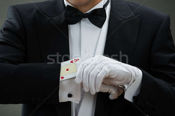 Magician Performing Magic Trick With Cards Stock photo © AndreyPopov