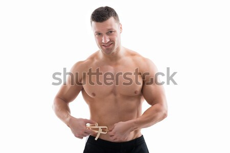 Muscular Man Measuring Fats With Caliper Stock photo © AndreyPopov