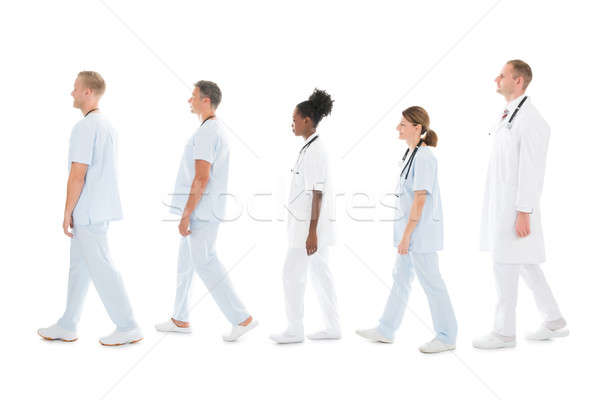 Side View Of Medical Team Walking In Row Stock photo © AndreyPopov