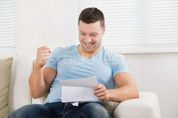 человека кулаком чтение письме диван счастливым Сток-фото © AndreyPopov
