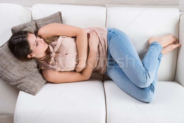 Young Woman Napping On Sofa Stock photo © AndreyPopov