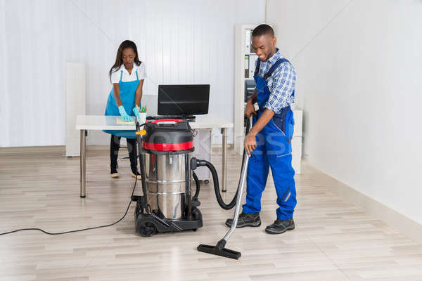 Male And Female Janitor Cleaning Office Stock photo © AndreyPopov
