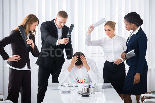 Businesspeople Blaming Male Colleague Stock photo © AndreyPopov