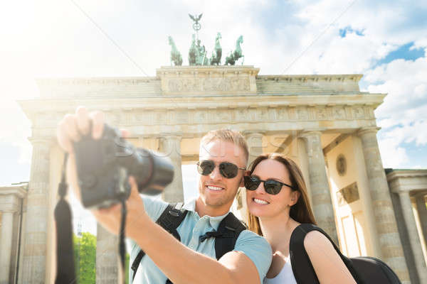 Stock photo: Young Couple Taking Selfie In Front Of Brandenburg Gate