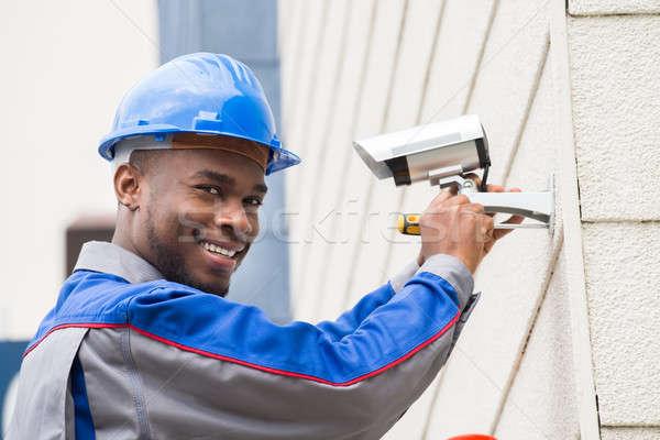 Male Technician Repairing Camera Stock photo © AndreyPopov