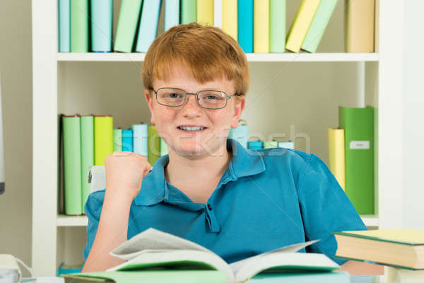 Smiling Excited Boy In Library Stock photo © AndreyPopov