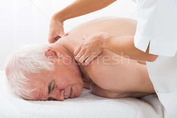 Man Receiving Back Massage Stock photo © AndreyPopov