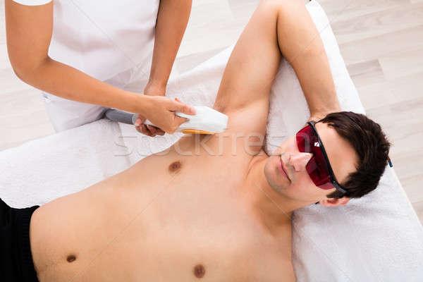 Therapist Giving Laser Epilation Treatment On Man's Armpit Stock photo © AndreyPopov
