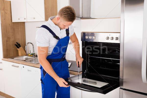 Technician Repairing Oven Stock photo © AndreyPopov