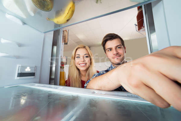 Woman Looking At Male Worker Repairing Refrigerator Stock photo © AndreyPopov