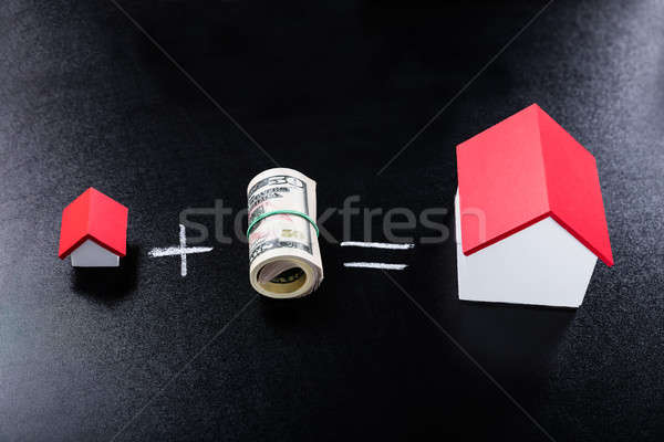 Rolled Dollar Banknotes And House Models Stock photo © AndreyPopov