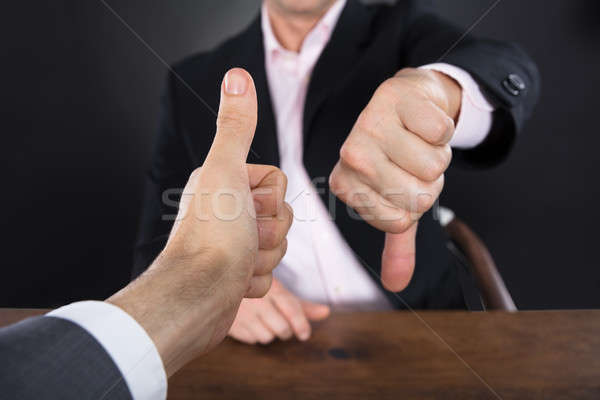 Two Businessmen Showing Like And Dislike Signs Stock photo © AndreyPopov