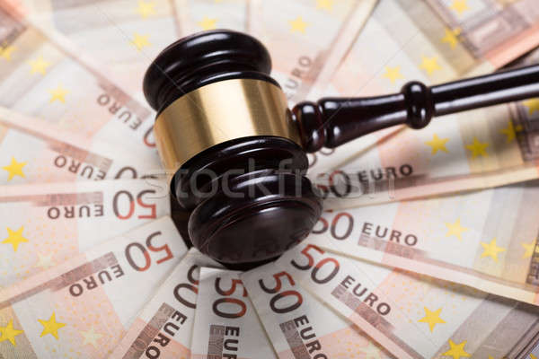 The Gavel Strike On Banknote Stock photo © AndreyPopov