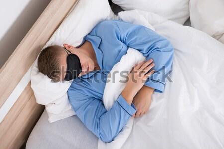 Doente mulher adormecido cama ver dor de estômago Foto stock © AndreyPopov
