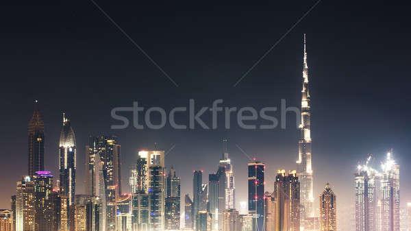 Linha do horizonte noite céu noturno negócio cidade Foto stock © AndreyPopov