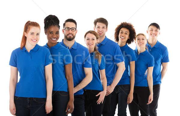 Grupy młodych stałego rząd biały uśmiech Zdjęcia stock © AndreyPopov