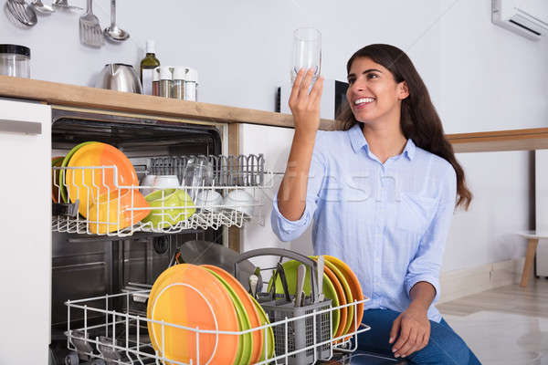Woman Looking At Clean Glass Stock photo © AndreyPopov