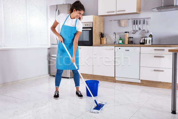 Woman Cleaning Floor With Mop Stock photo © AndreyPopov