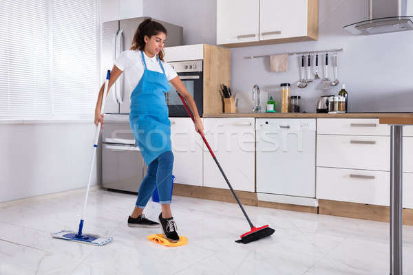 Female Janitor Multitasking Stock photo © AndreyPopov