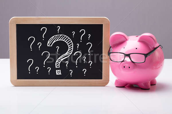 Piggy Bank With Eyes Glass And Blackboard Stock photo © AndreyPopov