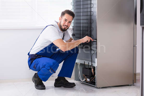 Technician Fixing Refrigerator Stock photo © AndreyPopov