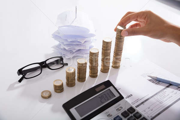 Accountant Stacking Coins Stock photo © AndreyPopov