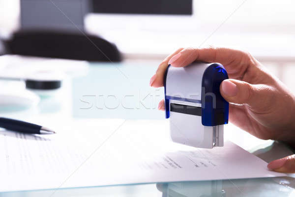 Close-up Of A Businessperson Stamping Document Stock photo © AndreyPopov