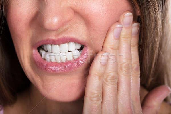 Nő szenvedés fogfájás kisajtolás arc fájdalmas Stock fotó © AndreyPopov