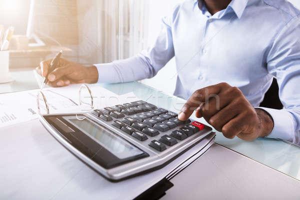 бизнесмен калькулятор месте бизнеса Сток-фото © AndreyPopov