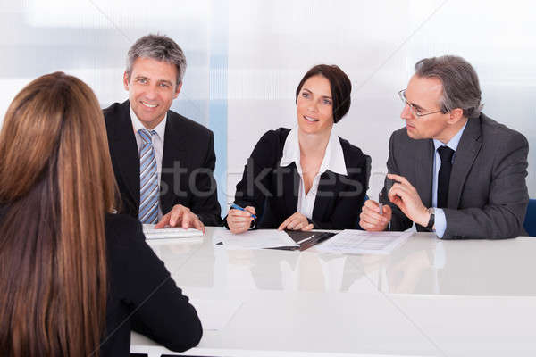 Businesspeople Interviewing Woman Stock photo © AndreyPopov