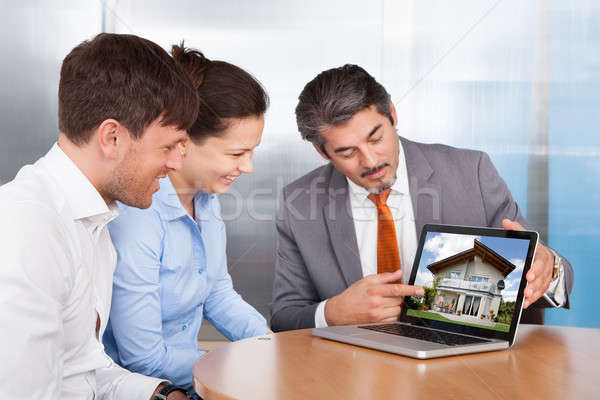 Couple And Consultant Discussing Together Stock photo © AndreyPopov