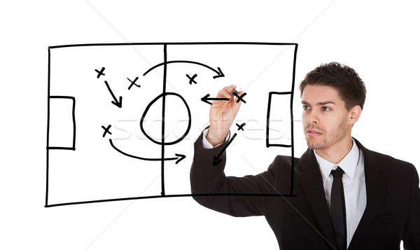 Juego estrategia pizarra hombre escrito partido de fútbol Foto stock © AndreyPopov