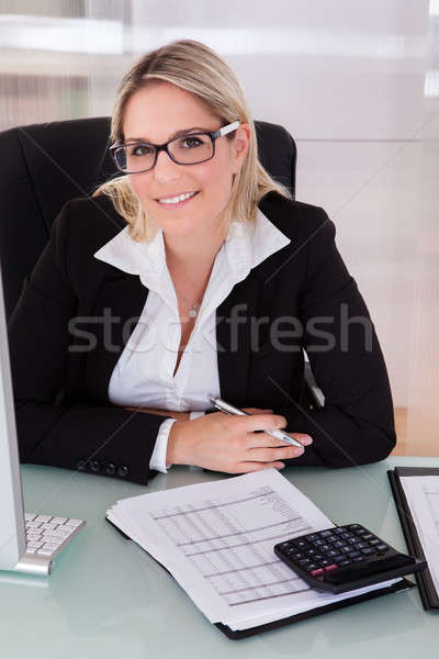 Businesswoman Working In Office Stock photo © AndreyPopov