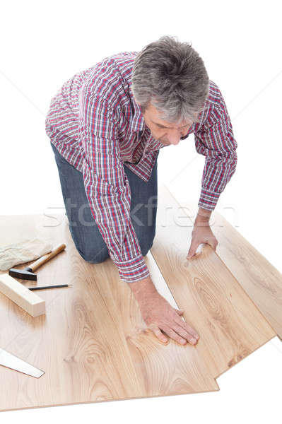 Stock photo: Worker assembling laminate floor