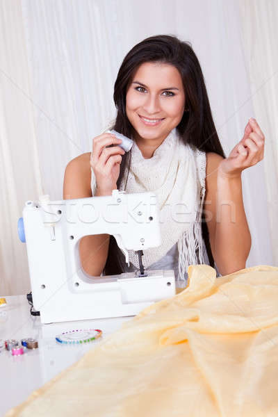 Woman threading her sewing machine Stock photo © AndreyPopov