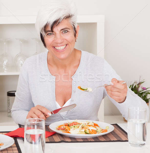 Senior woman eating a meal Stock photo © AndreyPopov