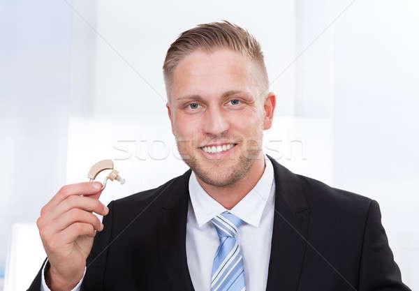 üzletember tart hallókészülék fotó férfi profi Stock fotó © AndreyPopov