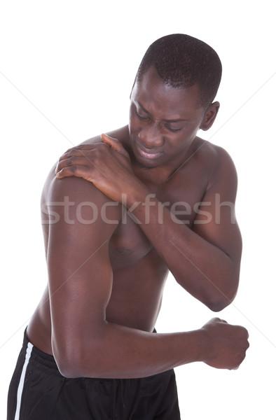 Man lijden schouderpijn shirtless afrikaanse jonge man Stockfoto © AndreyPopov