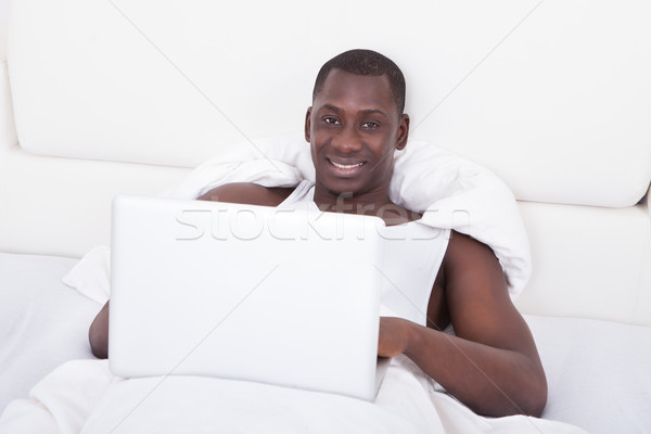 African Man Using Laptop Stock photo © AndreyPopov
