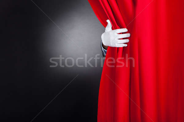 Magician Opening Red Stage Curtain Stock photo © AndreyPopov
