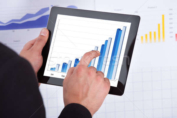 Businessman Analyzing Bar Graph On Digital Tablet Stock photo © AndreyPopov