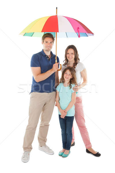 Portrait Of Family Standing Together Below Umbrella Stock photo © AndreyPopov