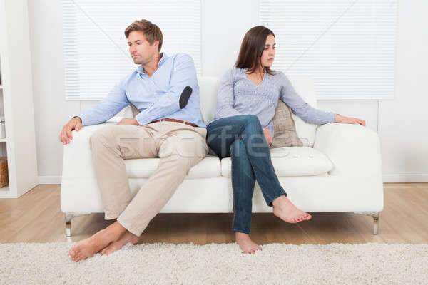 Couple Ignoring Each Other On Sofa Stock photo © AndreyPopov