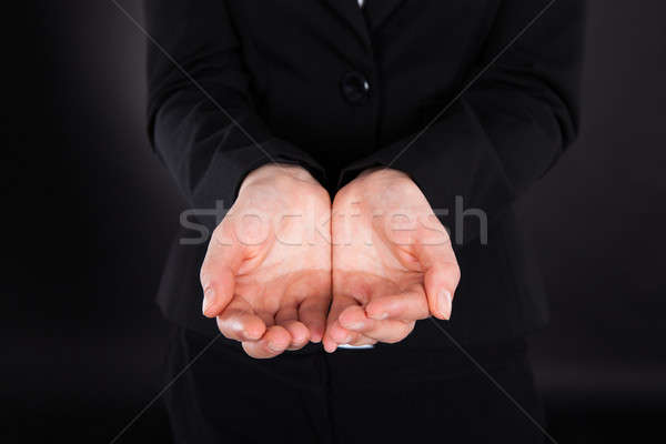Midsection Of Businesswoman With Cupped Hands Stock photo © AndreyPopov
