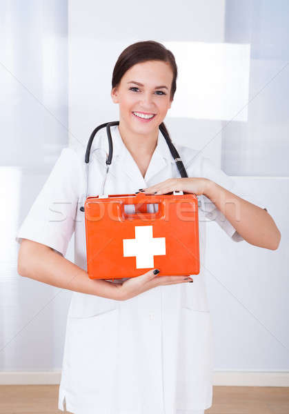 Happy Female Doctor Holding First Aid Box Stock photo © AndreyPopov