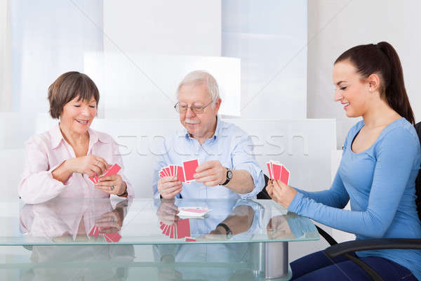 Caretaker Playing Cards With Senior Couple Stock photo © AndreyPopov
