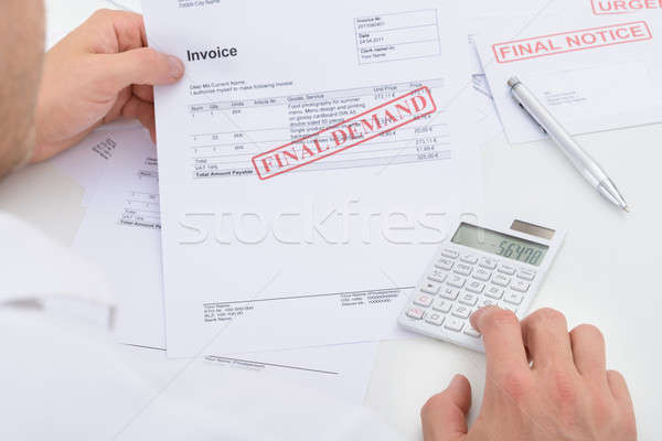 Man Calculating Invoice Stock photo © AndreyPopov