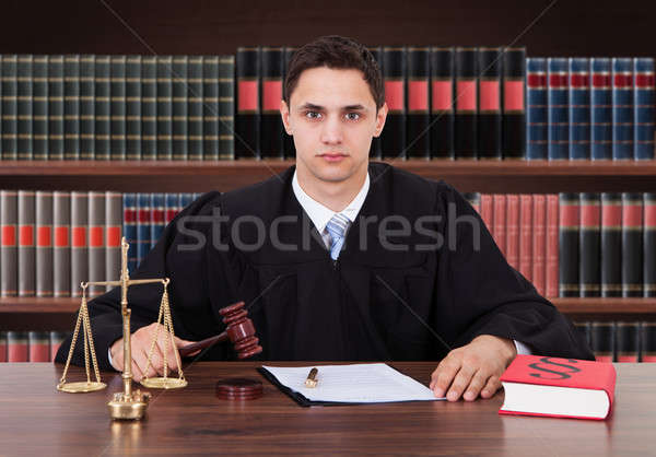 Confident Male Judge Sitting In Courtroom Stock photo © AndreyPopov